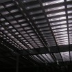 Industrial mezzanine underside of standard system with pre-formed flat steel deck