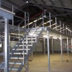 Industrial mezzanine in galvanized finish showing staircase & handrail