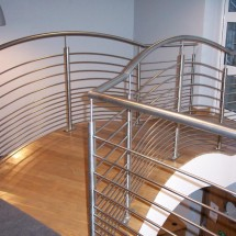 Stainless steel handrail to arched bridge