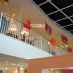 Retail mezzanine with curved open edge and feature balustrade