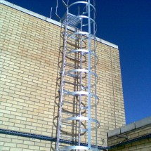Galvanised maintenance ladder with safety hoops