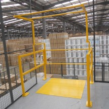 Up & over pallet gate in powder coated yellow finish complete with steel deck plate
