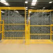 Up & over pallet gates in high visibility yellow finish complete with steel deck plate
