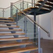 Feature staircase with hardwood timber treads, complete with bespoke stainless handrail