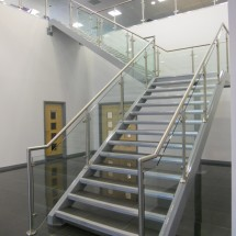 Bespoke feature staircase and stainless-glass handrail